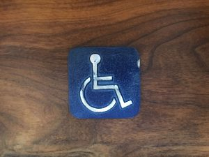 Antique Handicap Door Sign